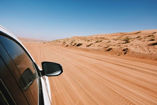 Point of view from the window off-Road car ride on road in desert area, Oman