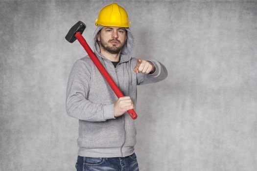 Portrait of a builder who shows you