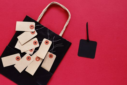 Mock up pf blank sale tag with shopping bag on red background, copy space,  shopping concept