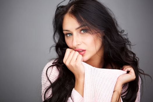 Close up mysterious beautiful woman holding sweater