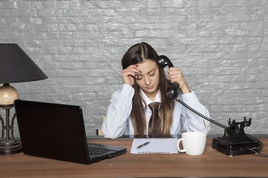 broken business woman, listens to bad news over the phone