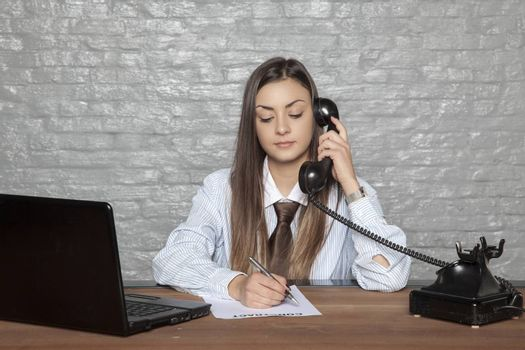 telephone conversation and signing documents at the same time by businesswoman