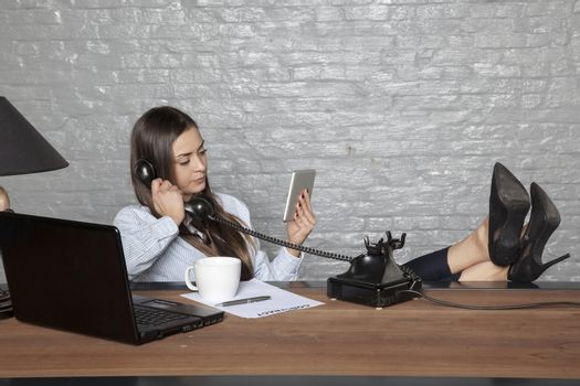 business woman busy with other activities than a phone call