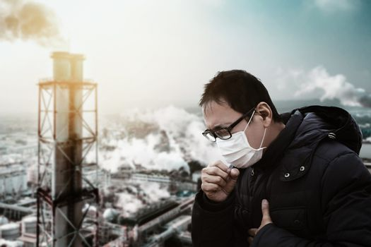 man wearing mask against smog  and  air pollution factory backgr