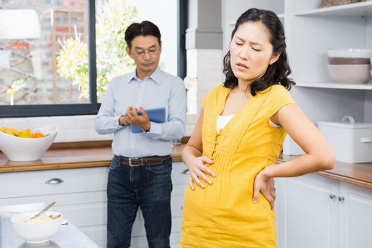 Pregnant woman with back ache