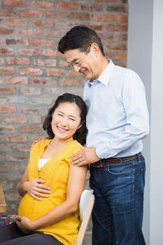 Portrait of happy expectant couple