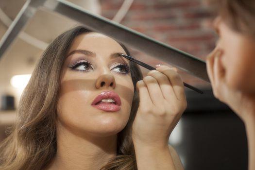 Young girl makeup her self