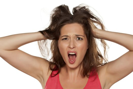 nervous young woman with itching in her hair