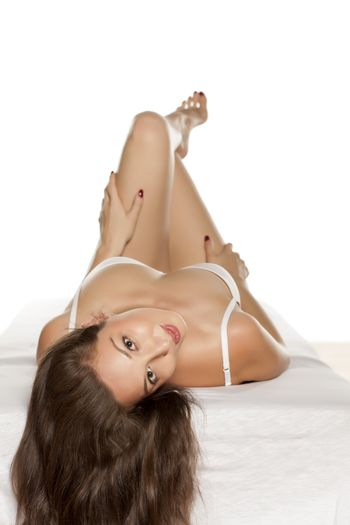 seductive young woman lying on the bed