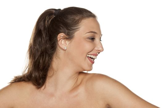 Profile of smiling young woman with a pony tail