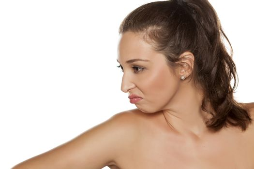 profile of young frowning woman with a pony tail