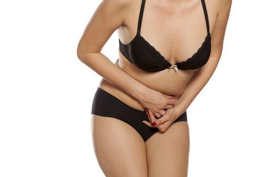 women in underwear has stomach pains