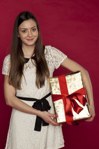 beautiful woman holding a gift in her hands