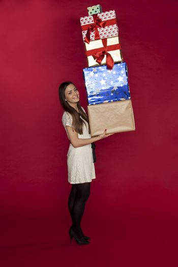 beautiful young woman carries a lot of gifts