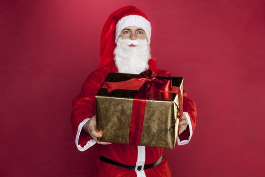 Santa Claus presents a gift