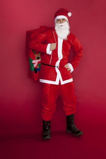 Cool Santa Claus stands with a bag full of gifts