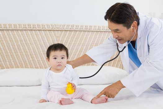 Doctor visiting cute baby