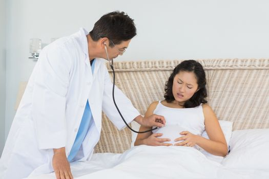 Doctor visiting pregnant woman