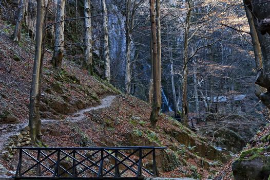 Autumn walk through the labyrinth of the Teteven Balkan with high peaks, river, bridge and waterfall, Stara Planina, Bulgaria