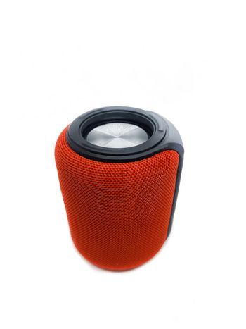 Mini red bluetooth speaker isolated on over white background.