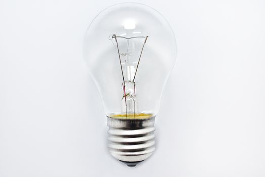 one incandescent bulb lying on white