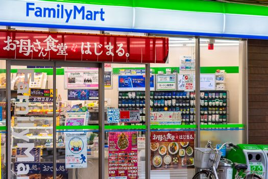 Storefront of a FamilyMart convenience store in Osaka, Japan