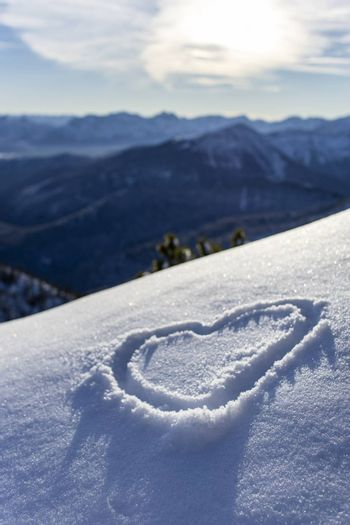 heart drawn in the fresh snow