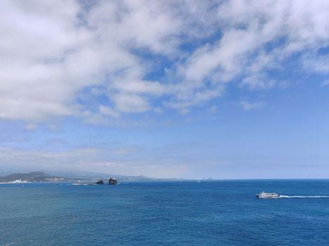 Breathtaking landscape shot of blue sea and cloudy sky in Jeju Island, South Korea