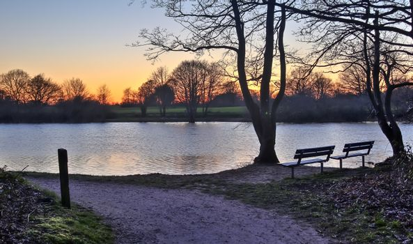Beautiful and romantic sunset at a lake in yellow and orange col