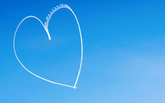 Romantic heart written by an aircraft in the sky, with copy space. Concept for Valentine's day
