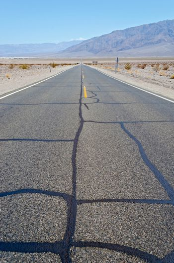 Hot desert road in Death Valley National Park, California, USA