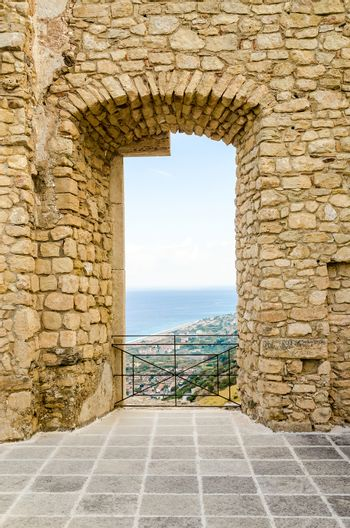 Ancient window from the ruins of an old castle with beautiful view over the sea