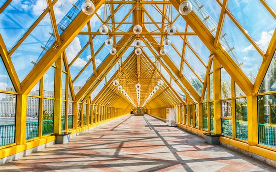 Walking inside Pushkinsky Pedestrian Covered Bridge near Gorky Park in central Moscow, Russia