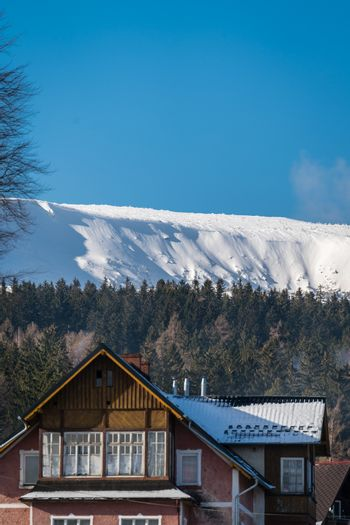 Traditional triangular roof of an old house on a sunny day in Karpacz town, polish winter ski resort, Poland