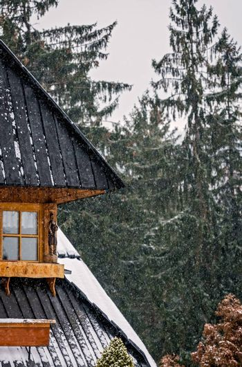 Close up of the traditional triangular roof of an old house in Karpacz town, polish winter ski resort, Poland