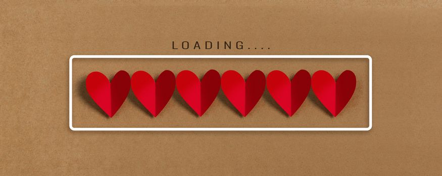 Loading progress bar with red hearts on brown paper background. Valentine's day, Love, Life concepts.