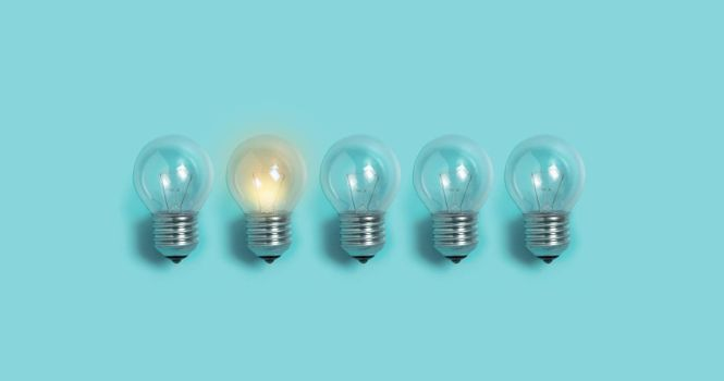 Light bulbs on blue background. Creative idea Concept.