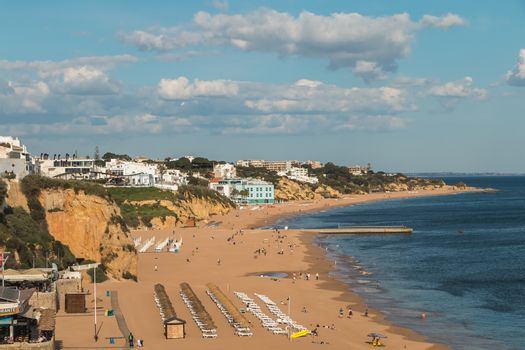Albufeira, Portugal - May 3, 2018: High view of the city beaches in a very tourist destination in southern Portugal, in the Algarve where people are resting on a spring day