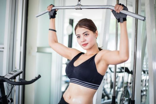 beautiful muscular fit woman exercising building muscles and fit