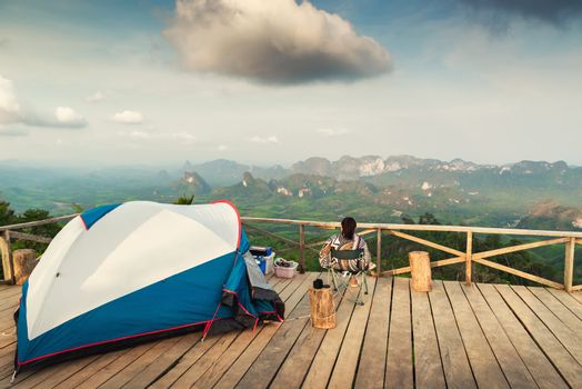 Landscape Scenery Mountains View With Camping Tent on Wooden Terrace for Outdoors Leisure Activity Relaxation. Beautiful Scenic of Nature From Camp Site Viewpoint, Adventure/Vacation Lifestyles