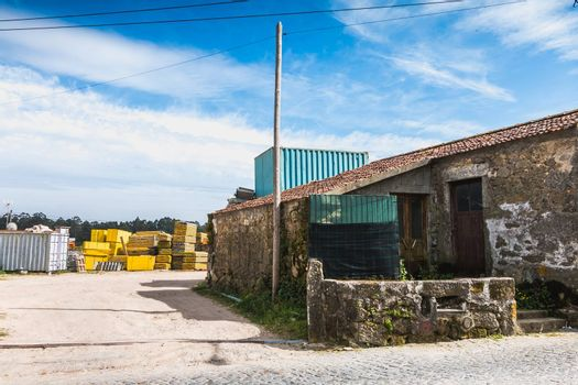 Vila Cha near Esposende, Portugal - May 9, 2018: Pallet wood storage in a company in the city center on a spring day