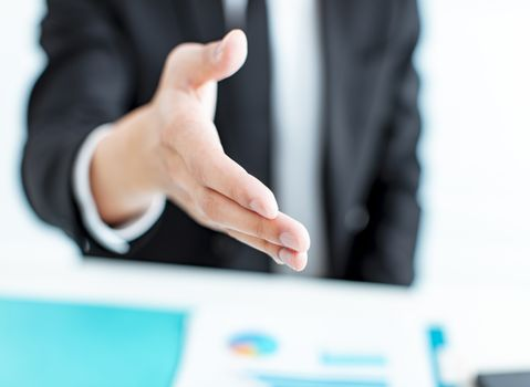 closeup businessman hand reaching out for a handshake