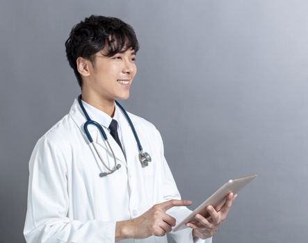 young Doctor using  digital tablet