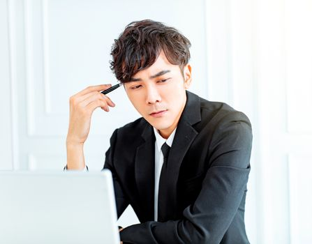 young business man thinking in office