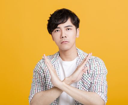 young man Refuse gesture, crossed hands
