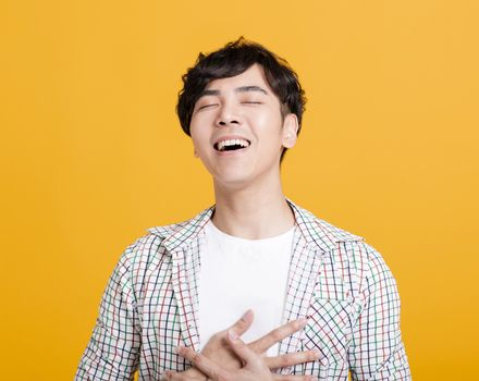happy Asian young  man with laugh face