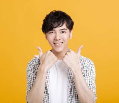 happy fyoung man  showing  thumbs up and good luck