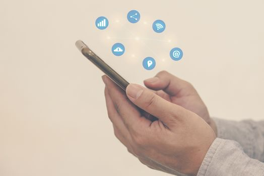 Man with a hand holding a smartphone on social media.Digital network  concept.