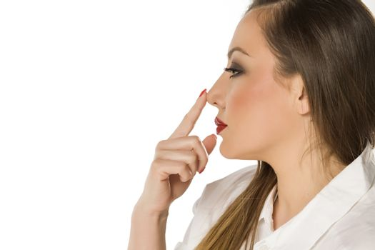 Beautiful woman touching her nose