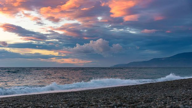 Picturesque sunset on the Calabrian beach in Italy